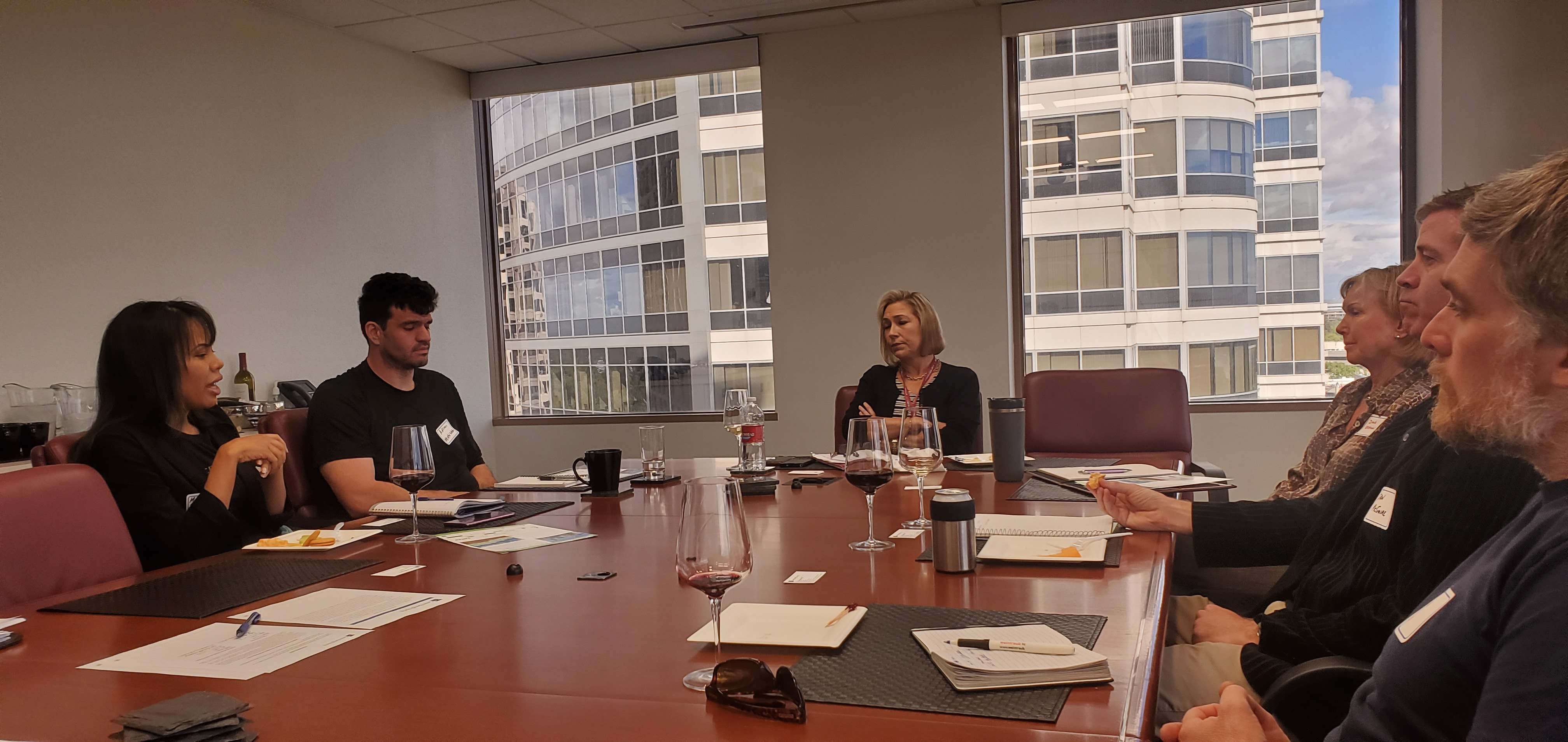 Michelle Hallsten of GT Law talks with attendees
