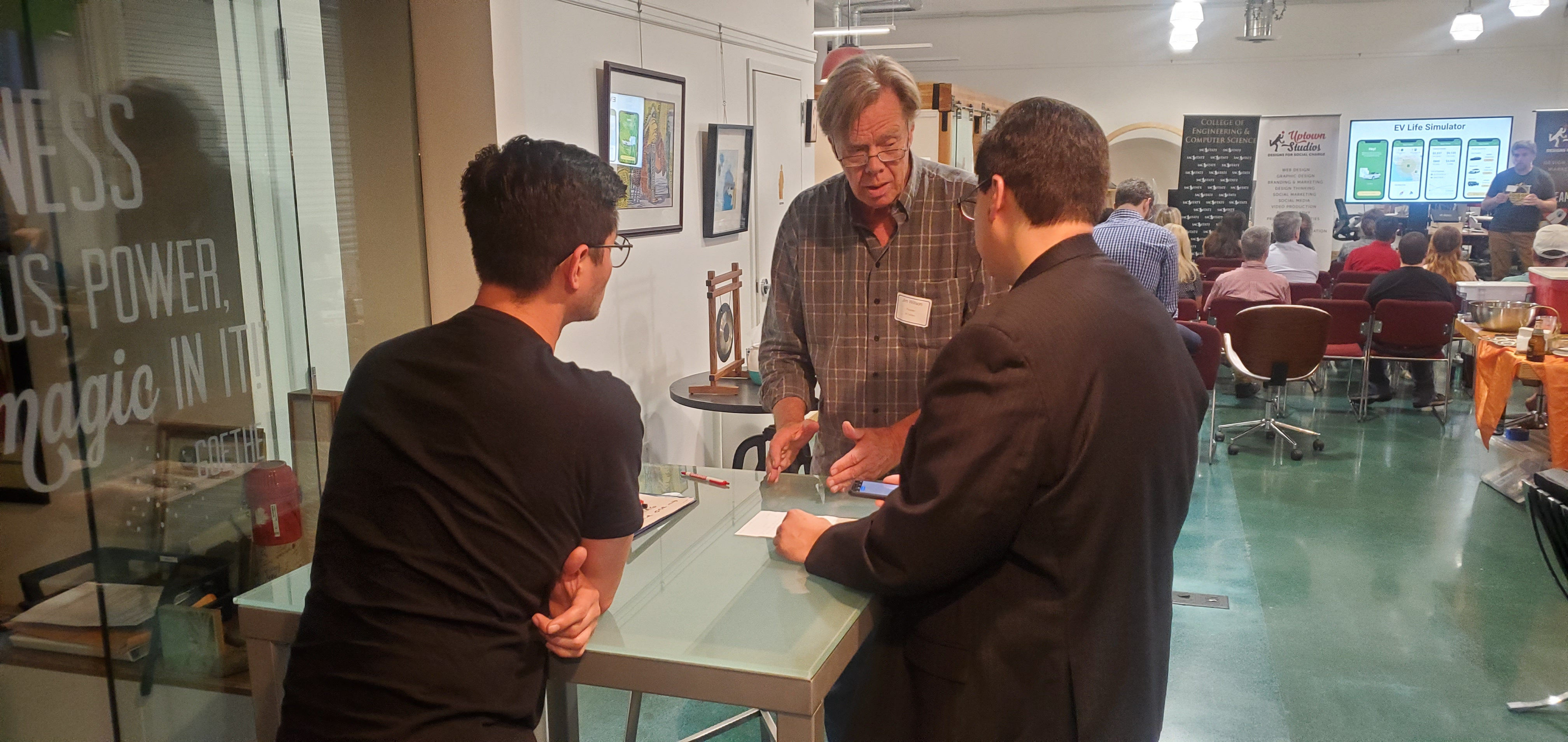 Prof Toups, CleanStart Ass Christian Maldonado talk with Jim